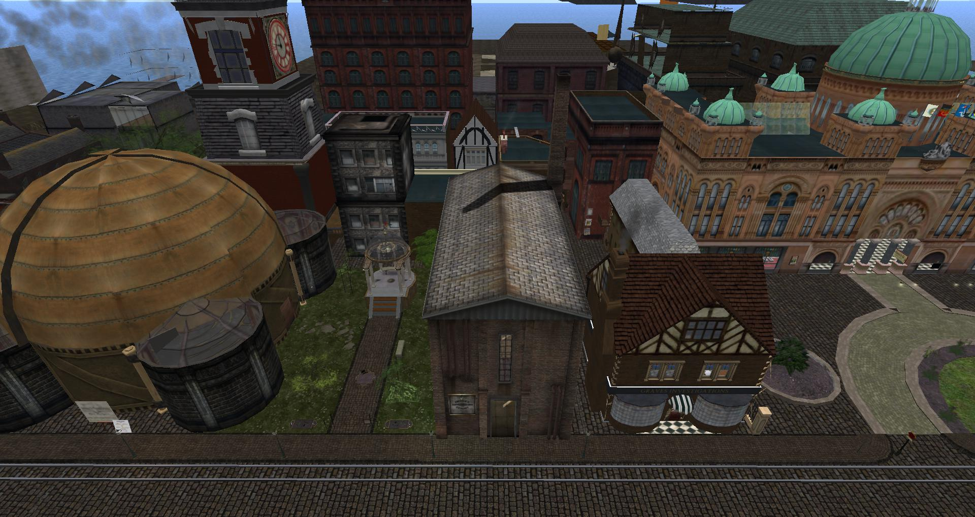 Fosdick's Astrobiology Exhibit virtual building (the eyesore building on the left, next to the quaint, inviting-looking building) in the steampunk City of New Babbage in Second Life (coordinates: 213, 57, 106).