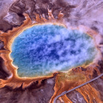 A volcanic hot spring - one of many unlikely abodes of archaea microorganisms. Might hardy microbes thrive elsewhere in the solar system and beyond?